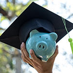graduation hat on piggy bank